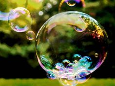 How to make your own bubble solution plus ideas for creating homemade bubble wands - fun and educational activity for kids on a warm, sunny day!