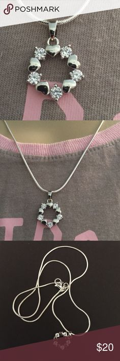 925 Sterling Silver Love Flower Necklace. New 925 Sterling silver plated heart and Zircon Pendant necklace. Necklace is also plated. It's 18 inches long. Didn't come with the pendant. Jewelry Necklaces