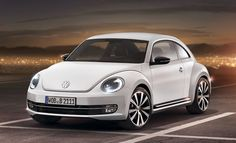 Defiantly going to buy a white one!    Image from http://images.thecarconnection.com/lrg/volkswagen-new-beetle_100346731_l.jpg.