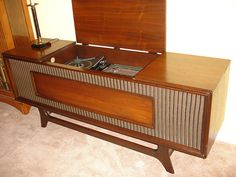 General Electric stereo console. Ah yes this the beast I just bought, awesome!...great buy! This piece is beautiful!