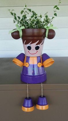 Check out this item in my Etsy shop https://www.etsy.com/listing/400148385/little-girl-planter-pot-person-with