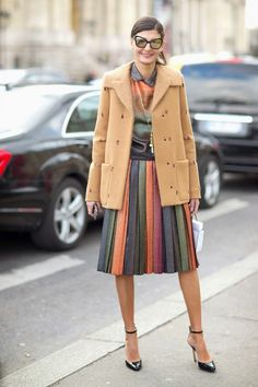 #Model #Off #Duty - Giovanna Battaglia. Fashion Director, freelance stylist and L'Uomo Vogue editor, Giovanna Battaglia, amped up her color game by wearing a gradient top with matching pleated rainbow skirt. Monochrome but not quite. She toned down the prismatic look with a camel coat and accessorized with ankle-strapped heels and sunglasses.