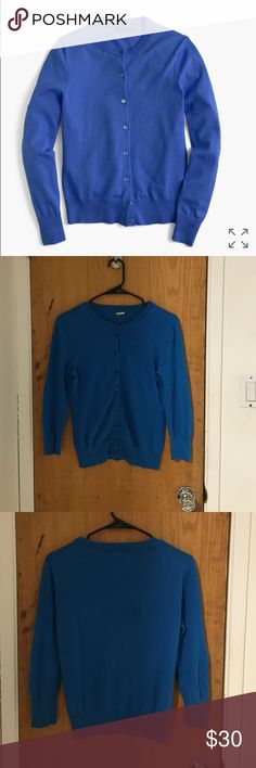 Blue J. Crew Cardigan used condition, worn many times. minimal piling & one small hole on the back shown in the fourth picture. PC: jcrew.com J. Crew Sweaters Cardigans