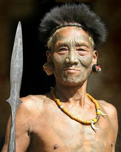 People portrait photograpy.  Travel Photography. https://flic.kr/p/EaCSHp | Konyak Naga | India. The north-eastern seven sister states. Nagaland. Longwa a Konyak village in  Mon area situated on the Myanmar-India border. The border literally divides the Angh's house in 2. The angh takes his meals in India and sleeps in Myanmar.
