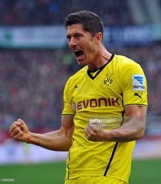 Robert Lewandowski of Dortmund celebrates scoring his goal during the Bundesliga match between Hannover 96 and Borussia Dortmund at HDI-Arena on March 22, 2014 in Hanover, Germany.