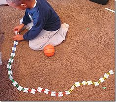 LOVE THIS! You have to see the full range of ideas at this site...great for fine motor skills, motor planning (I bet it takes some kids a while to figure out how to attach the link to the card), bilateral coordination as well as whatever academic skill you want to target...can you tell this excites me!!!!
