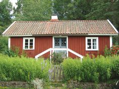 Adorable little red house in the Swedish countryside. Used to be a workers cottage and is now a summer home.