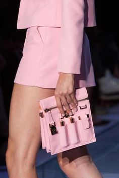 VERSACE: It's hard not to dig this pink bag with exterior pockets that hit the runway at Versace.