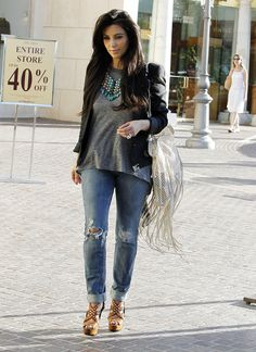 Kim Kardashian. Loving the statement necklace with this