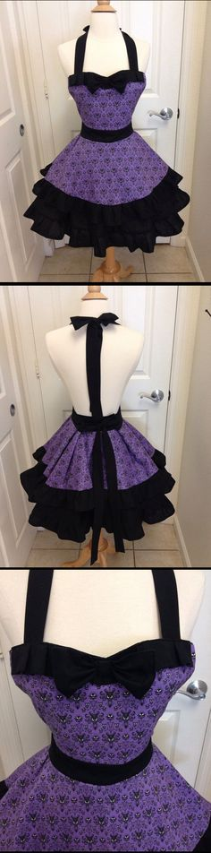 It's a Haunted Mansion 'Welcome, Foolish Mortals' Halloween Party, so what does the Ghost Hostess wear? Why, a Haunted Mansion maid's apron, of course!