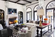 kardashians love the Moroccan influence, black and white color scheme and black windows/white walls