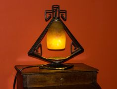 Art deco lamp, made from cast iron and glass paste. Made by Daum Frères (Nancy, France).