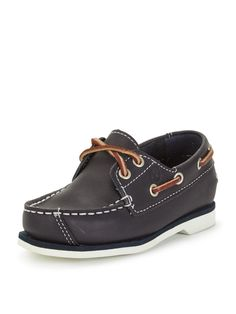 TimberlandBoys Seabury Classic Boat Shoes A comfortable classic, this smart pair of boys boat shoes by Timberland will add a preppy finish to his outfits. Featuring a smooth and quality upper, the navy shoes boast a traditional silhouette with contrast stitching and nautical-inspired rope side detail. Styled with a tongue and criss-cross rope, the contrasting white rubberised sole provides traction with excellent grip underneath.