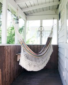 Laidback Summer Style: 10 Perfect Porches | Apartment Therapy I wish I had the space for a hammock. The porch is even too small for that alone.