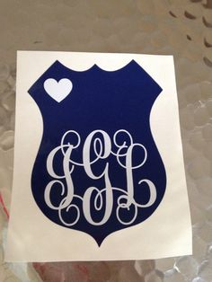 A personal favorite from my Etsy shop https://www.etsy.com/listing/475662723/police-badge-monogram-vinyl-decal-police