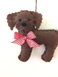 This chocolate labradoodle ornament makes a great gift for someone who loves labradoodles. He is designed and handmade by me! He is 4 1/2 inches tall and lightly stuffed. Find more cute felt ornaments here