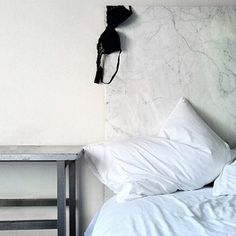 Marble headboard by the incomparable Whorehaus Studios.