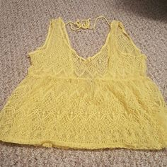 Yellow tank Yellow open back tank excellent condition never worn Vanity Tops Tank Tops