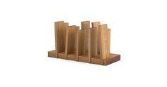Nápaditý držiak novín a časopisov z masívneho dreva od talianskej návrhárky Eugenie Minerva.