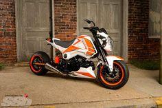 2014 Honda Grom by Garwood Custom Cycles. http://garwoodcustomcycles.com/new_vehicle_detail.asp?veh=367554&pov=3662117 and/or http://powersports.honda.com/2014/grom.aspx and/or http://superstreetbike.com/flash-honda-grom