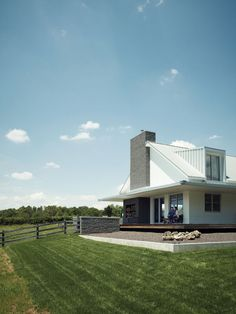 Extended outdoor view of modern house with wraparound porch
