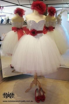This would be an ideal dress for a flower girl with little red sandals, a little red headband, and a basket full of red roses!