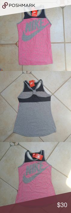 NWT NIKE RACERBACK TANK NWT NIKE RACERBACK TANK Brand: Nike  Size: Girls/Juniors Large (Runs big fits like women's small) Style #:811571 Racerback Tank, workout in style! Fabric: 60% Cotton 40% Polyester Fast shipper, top rated seller, BUNDLE discount, posh mentor! Bundle & save!! Nike Tops Tank Tops