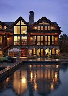 The windows, the reflection off the pool...night swimming under the stars...    Put this in the mountains near a beautiful lake and you'd have to pinch me everyday I'd get to wake up here:)))
