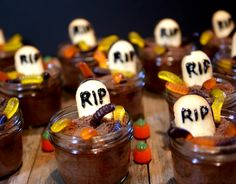 Mason Jar Graveyard Spooky Cakes      Recipe from: Created by Noble Pig | Serves: 11 cakes          Ingredients        	1 Devil's Food Boxed Cake Mix or other chocolate flavor  10 sheets chocolate graham crackers, pulverized into crumbs  1 cup chocolate frosting  1 tube black cake decorators gel  11 Pepperidge Farm Milano Cookies  44 gummy worms  chocolate sprinkles