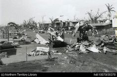 Loader, dozer and truck used to clean up the corrugated iron after Cyclone Tracy, Bouganvillia Street. Northern Territory Library.