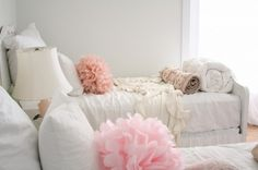 muted bedding with a hint of color via accents... imagine the walls with a pop of color... perfection!