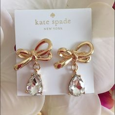 Take20%offKate Spade Tied Bow Drops Earrings Beautiful Kate Spade signature tied up bow with clear tear drop earrings.  NEW.  Comes with Kate Spade earrings plate holder as shown. kate spade Jewelry Earrings