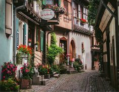 Post with 3969 views. This cozy back alley I stumbled upon in the small French village Eguisheim Warm Paint Colors, Purpose Of Travel, Cozy Reading Corners, Wall Mount Electric Fireplace, Neutral Bedrooms, Warm Winter Hats, Oui Oui, Luxury Homes Interior, Cozy Place