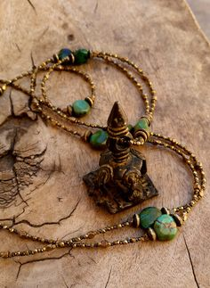 Antique India Brass Sacred Stamp with Chinese Green Turquoise and Antique French Steel Cut Metal Beads by DesertTalismans on Etsy