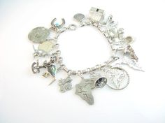 Vintage Charm Bracelet Sterling Silver Exotic by bohemiantrading, $265.00