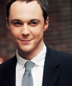 Jim Parsons- feeling uncomfortable with the realization that the dude that plays Sheldon is a little bit hot...  Possibly because this little mischievous attempt at holding back a smile reminds me of my guy :)