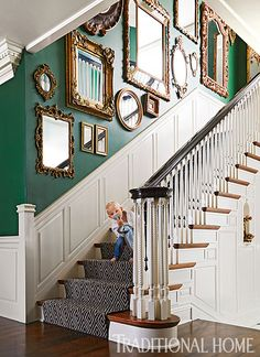 Decorating with antique mirrors This gallery wall arrangement of mismatched mirrors makes a pretty statement along a stairwell wall. We especially love the way the gilded gold pops against the emerald wall. This look is exciting but still works well with a traditional decor style. Saved from:http://skicountryantiques.com/blogs/news/decorating-with-antique-mirrors