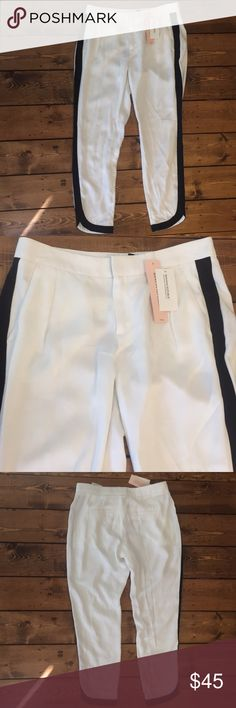 Beautiful white cropped pants with black stripes! Beauty white dress pants from Banana Republic, black stripes down the side of the legs!   New with tags!  Feel free to make an offer! Banana Republic Pants Ankle & Cropped