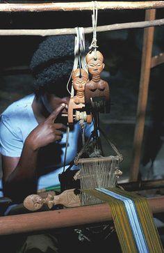 "Africa | Woman weaving strips of cloth on a 4"" loom. | Via Earth Metropolis African Art"