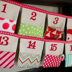 Christmas Advent Calendar Fabric Bunting in Linen with bright red, green pockets. $80.00, via Etsy.
