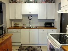 simply chic treasures: kitchen makeover. Adding beadboard and trim to cabinets to give them a face lift.