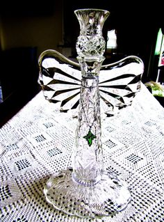 This lovey Angel sculpture has been created by Adele with vintage glass items. A pattern glass vase was used for the body. A pickle dish serves Glass Garden Flowers, Glass Plate Flowers, Glass Garden Art, Flower Plates, Garden Whimsy, Diy Garden, Garden Crafts, Diy Crafts, My Glass