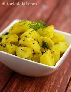 Bateta nu shaak is one of the most popular gujarati foods, made in almost every household. A wonderful combination of sesame seeds, curry leaves and ginger-green chilli paste giver a very distinct flavour to the otherwise bland potatoes. Lemon juice and coriander added towards the end really perk up the dish. It tastes best when served with dal and rice.