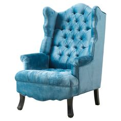 Velvet-upholstered wingback arm chair with diamond tufting and nailhead trim.   Product: ChairConstruction Material...