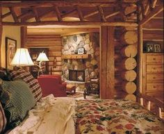 By day, you may rough it in the great outdoors, but at night, this master bedroom offers luxurious comfort. A romantic fireplace and layers of downy bedding ensure sweet dreams.