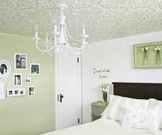 Lookup! Don't forget your ceiling when considering changing the wall color and repainting. These inexpensive ceiling projects use paint to add interest to your room. Us one color one your ceiling or add color such as a checker pattern.