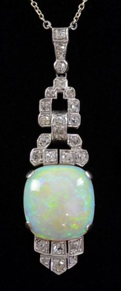 Art Deco opal and diamond set negligee pendant pendant SIZE CORRECTION 50.47 x 14.40 x 6.19 , mm Opal 8 carats , diamond weight .5 carat