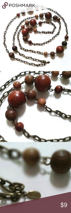 Vintage Boho Aero chain with wood beads necklace This is a Aero wood bead necklace.  Its chain is a bronze color while the wood beads are in different earthy colors. This necklace slips over the head. Aero Jewelry Necklaces