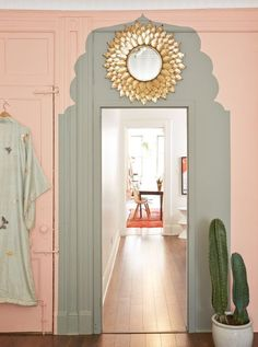 Pink Bedroom with faux painted Moroccan-inspired arch over doorway.