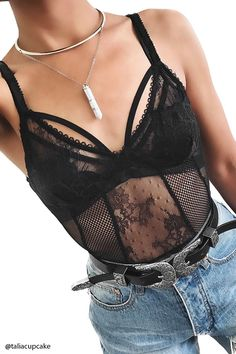 A knit bodysuit featuring crochet lace with floral embroidery, mesh panels, adjustable spaghetti straps, a slide-hook closure, back cutout, and snap-button closure. This is an independent brand and not a Forever 21 branded item.